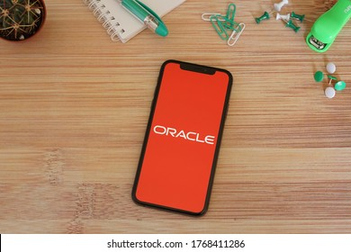 Barcelona, Spain - July 02, 2020; Oracle App with Green Stationery on a Bamboo Desk. Oracle is an American multinational computer technology corporation. #Oracle