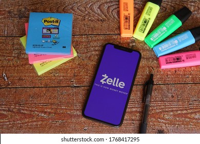Barcelona, Spain - July 02, 2020; Zelle Iphone Screen with Hilighter and Colored Stickynotes. Zelle is a United States-based digital payments network.