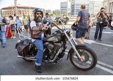 BARCELONA, SPAIN - JULY 07: Unidentified persons with a Harley Davidson motorbike at an exhibition during BARCELONA HARLEY DAYS 2013, on July 07, 2013, Barcelona, Spain.