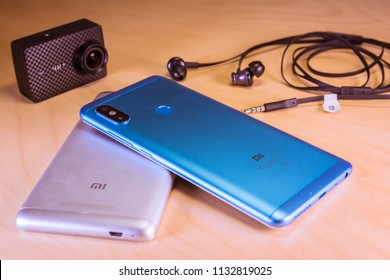 Barcelona, Spain. July 10: Xiaomi corp top gadgets: Redmi note 5 smartphones, headphones and yi 4k action camera on a table. Ilustrative editorial