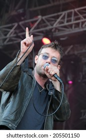 "BARCELONA, SPAIN - JULY 11, 2014: Damon Albarn, singer from Blur and Gorillaz, performing live his solo tour ""Everyday Robots"" in Cruilla Barcelona Festival."