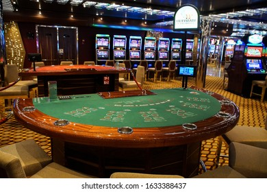 Barcelona, Spain, July 11, 2016 : Casino interior room with blackjack Table and slot machines on a cruise boat. Gambling entertainment concept.