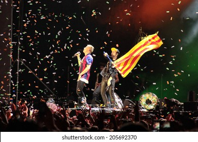 BARCELONA, SPAIN - JULY 12, 2014: Grammy winners Macklemore & Ryan Lewis showing a Catalonia flag during his concert in Cruilla Barcelona Festival. Macklemore wears a FC Barcelona football team shirt.