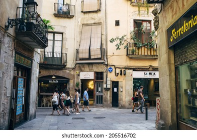 BARCELONA, SPAIN - JULY 12: Tourists visit El Born neighborhood in Barcelona, Spain, on July 12, 2014. El Born is a trendy area in Barcelona that has become a major tourist attraction.