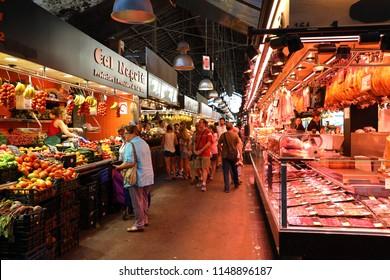BARCELONA, SPAIN - JULY 13, 2018: people shop in Barcelona Market (Mercat de Sant Josep de la Boqueria), a large public market with entrance near La Rambla street