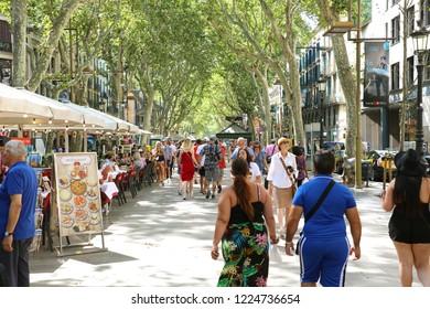 BARCELONA, SPAIN - JULY 13, 2018: people walking in famous pedestrian area La Rambla in Barcelona, Spain
