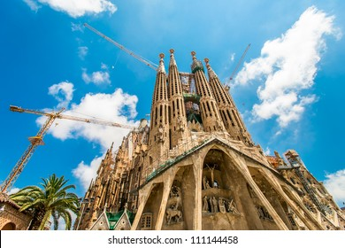 BARCELONA, SPAIN - JULY 13: Sagrada Familia on July 13, 2012: La Sagrada Familia - the impressive cathedral designed by Gaudi, which is being build since 19 March 1882 and is not finished yet.