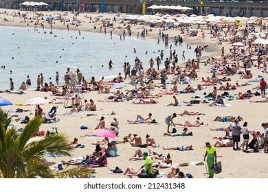 BARCELONA, SPAIN - JULY 15, 2014: Beach of Barcelona in summer.  Mediterranean coast in Catalonia