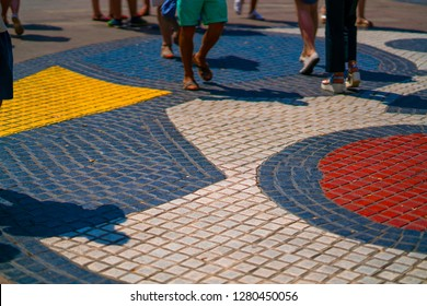BARCELONA, SPAIN - July 15, 2018: Detail from the Pla de l'Os, a small square featuring a mosaic design by famous painter Joan Miro.