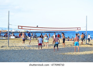 Barcelona, Spain - July 16th 2016: youth group playing beach volley