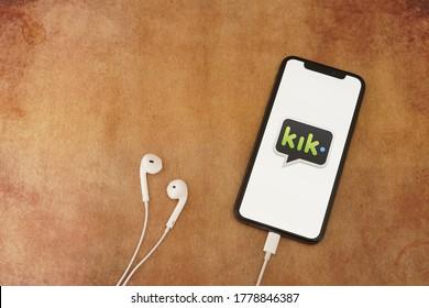 Barcelona, Spain - July 18, 2020; Kik App with Earpiece on a Rustic Paper. Kik is an im mobile app by Kik Interactive. #kik