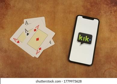 Barcelona, Spain - July 20, 2020; Kik App on a Vintage Paper with Ace Cards. Kik is an im mobile app by Kik Interactive. #kik
