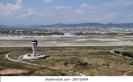 BARCELONA, SPAIN - JULY 20: Control tower of Barcelona El Prat Airport seen from the distance on July 20, 2014 in Barcelona, Spain.