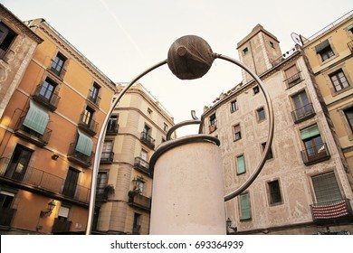 BARCELONA, SPAIN - JULY 2017:George Orwell square in gothic quarter of Barcelona. Facade houses and sculpture reproduction of one work of surreal sculptor Leandre Cristofol.