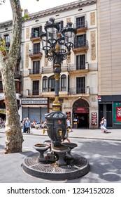 Barcelona, Spain - July 2018: Canaletes fountain on La Rambla street