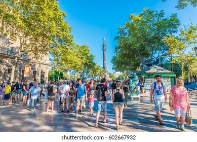 BARCELONA, SPAIN - JULY 24, 2016: Street view of La Rambla in Barcelona, Spain. Barcelona is the capital city of the autonomous community of Catalonia in the Kingdom of Spain.