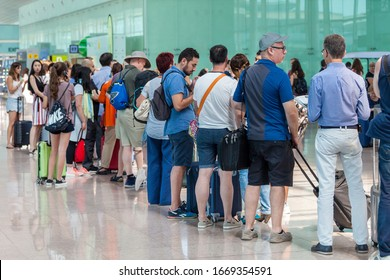 BARCELONA, SPAIN - JULY 24, 2017: Tourists waiting boarding in the queue at the gate in the airport