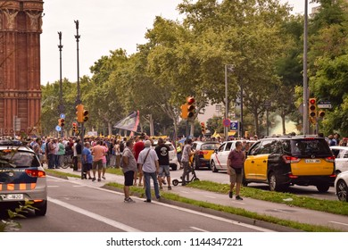 Barcelona, Spain - July 25, 2018: Taxidrivers demonstrate against too many licenses in Barcelona next to the Arc de Triomf. Their labor union causes traffic jams in many street.