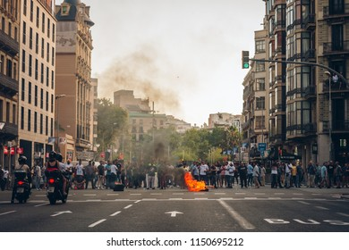 Barcelona, Spain - July 27, 2018: Taxi strike over Uber and Cabify. Drivers protesting, cars blocking city street in Catalunya
