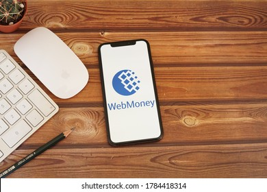 Barcelona, Spain - July 27, 2020; Webmoney App with Keyboard and Mouse on a Wooden Desk. WebMoney is an online payment settlement system. #WebMoney