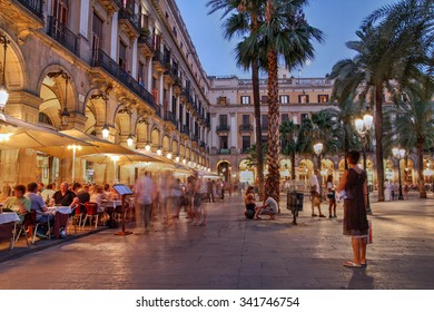 BARCELONA, SPAIN - JULY  30: Placa Reial (Royal Plaza), one of the most lively squares in Barcelona, Spain on July 30, 2012. It is located in the Barri Gothic quarter, close to Las Ramblas.