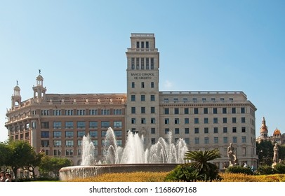 BARCELONA, SPAIN - JULY 31, 2012: View over Plaza Catalunya fountain and Banco Espanol building on a sunny summer day on July 31, 2012 in Barcelona, Spain.