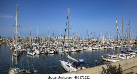 BARCELONA, SPAIN - JULY 4, 2016: Yachts and sailboats moored in the Port Vell of Barcelona, Catalonia, Spain