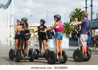 BARCELONA, SPAIN - JULY 6, 2014: Tourists sightseeing on a Segway tour of Barcelona, Spain