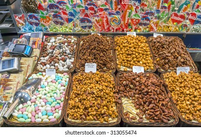 BARCELONA, SPAIN - JULY 6, 2015: Nuts and almonds for sale at the Mercat de Sant Josep de la Boqueria in Barcelona. It is a large public market in the Ciutat Vella district of Barcelona.