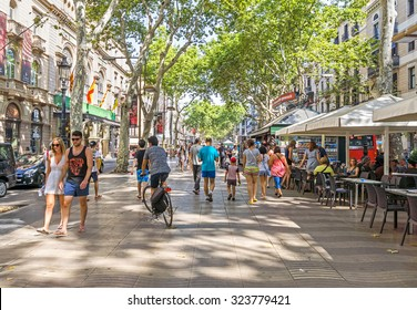BARCELONA, SPAIN - JULY 6, 2015: Hundreds of people promenading in the busiest street of Barcelona, the Ramblas.