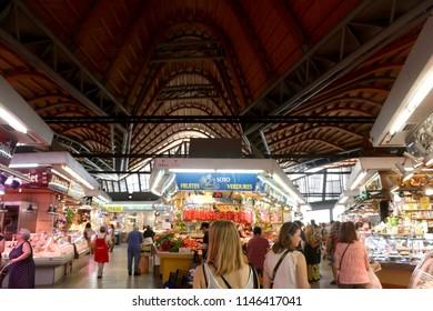 Barcelona, Spain - July 7, 2018: Tourist and locals visiting Mercat de Santa Caterina market in Barcelona, Spain.