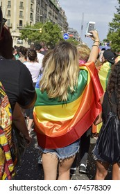 BARCELONA, SPAIN - JULY 8, 2017: People taking part in the gay pride parade in Barcelona, Spain, running by the famous Parallel Avenue