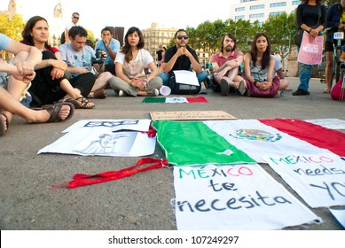 "BARCELONA, SPAIN. JULY 8TH: Unidentified Mexican citizens from the ""#YoSoy132"" movement protest against the electoral fraud in Mexico, on 08/July/2012 in Barcelona Spain"