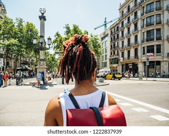 BARCELONA, SPAIN - JUN 1 2018: POV at people crossing street in Central Barcelona center to the iconic Rambla dels Estudis pedestrian street