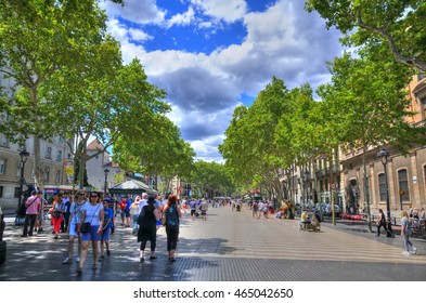 BARCELONA. SPAIN, JUN 16: colorful HDR image of  the famous La Ramblas street with unidentified walking tourists in Barcelona, Spain on June 16, 2016