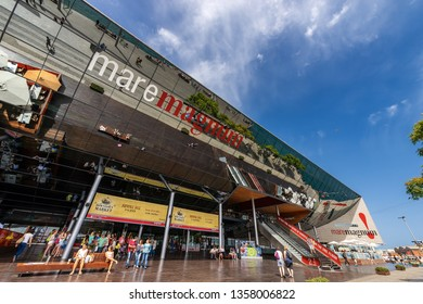 BARCELONA, SPAIN - JUN 9, 2014: exterior of the Maremagnum or Mare Magnum, large shopping mall, leisure center with shops and restaurants built at Port Vell area. Catalonia, Spain