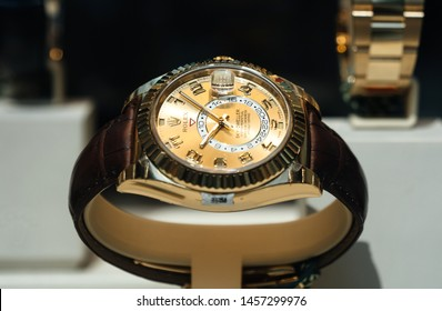Barcelona, Spain - Jun1 1, 2018: Modern new last collection of luxury gold wrist Swiss watch manufactured by Rolex model Sky Dweller in the official store distributor store showcase in central