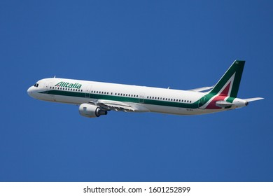 Barcelona, Spain - June 02, 2019: Alitalia Airbus A321 banking left after taking off from El Prat Airport in Barcelona, Spain.