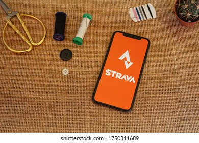 Barcelona, Spain - June 06, 2020; Strava App with Scissor and Sewing Tool. Strava is a social-fitness network app. #Strava