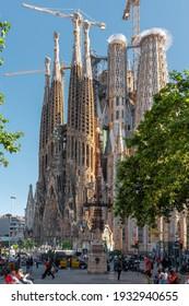 BARCELONA, SPAIN - JUNE 07, 2019: People and tourists enjoying everyday life in downtown Barcelona city, near Sagrada Familia