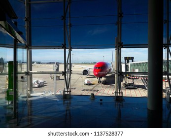 Barcelona, Spain - June 09, 2018: view through the window of the waiting room on the plane waiting for departure from the airport