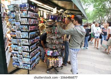 BARCELONA, SPAIN - JUNE 09: Souvenir shop at La Rambla street on June, 2013 in Barcelona, Spain. The central street in cite most popular touristic site in Barcelona