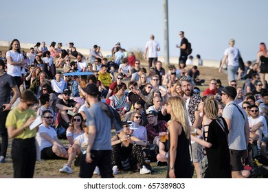 Barcelona, Spain - June 10, 2017: young people sit and wait for concert to start