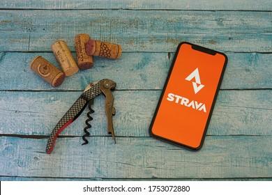 Barcelona, Spain - June 10, 2020; Strava App with Wine Opener and Corks. Strava is a social-fitness network app. #Strava