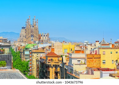 Barcelona, Spain - June 12, 2017: Basilica of La Sagrada Familia against blue sky. Most amazing and fabulous creations of the great architect Antoni Gaudi, construction has began in 1882.