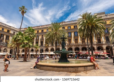 BARCELONA, SPAIN - JUNE 13, 2014: Placa Reial or Plaza Real (Royal square), with the bronze fountain of the Three Graces, in the Barri Gotic quarter of Barcelona, Catalonia, Spain