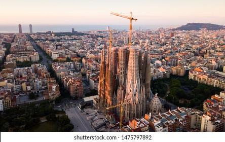 Barcelona, Spain - June 13, 2019: Aerial panorama view of Barcelona city skyline and Sagrada familia at dusk time