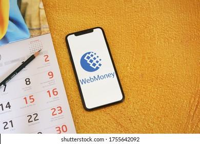 Barcelona, Spain - June 14, 2020; Webmoney App with Calendar on a Yellow Background. WebMoney is an online payment settlement system. #WebMoney