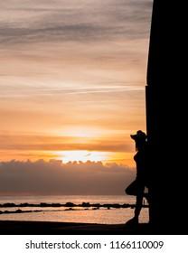 Barcelona / Spain - June, 17 2018, Woman looking the sunset near Barcelona Spain