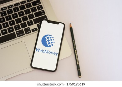 Barcelona, Spain - June 19, 2020; Webmoney with Macbook and Green Pencil. WebMoney is an online payment settlement system. #WebMoney